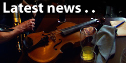 laterst news... - image of a fiddle on a table in a session
